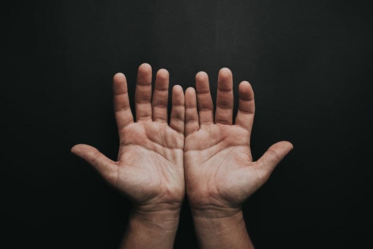 two hands held palms facing the camera