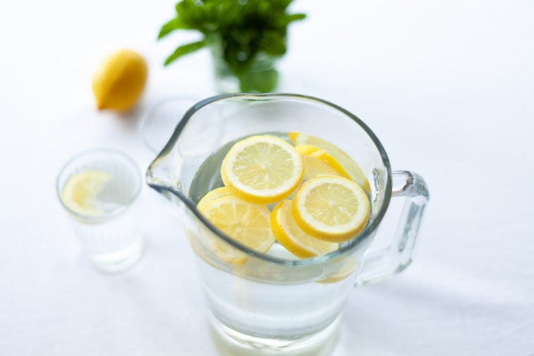 lemons in a pitcher of water