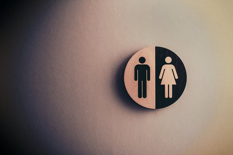 a bathroom stall indicating men and women